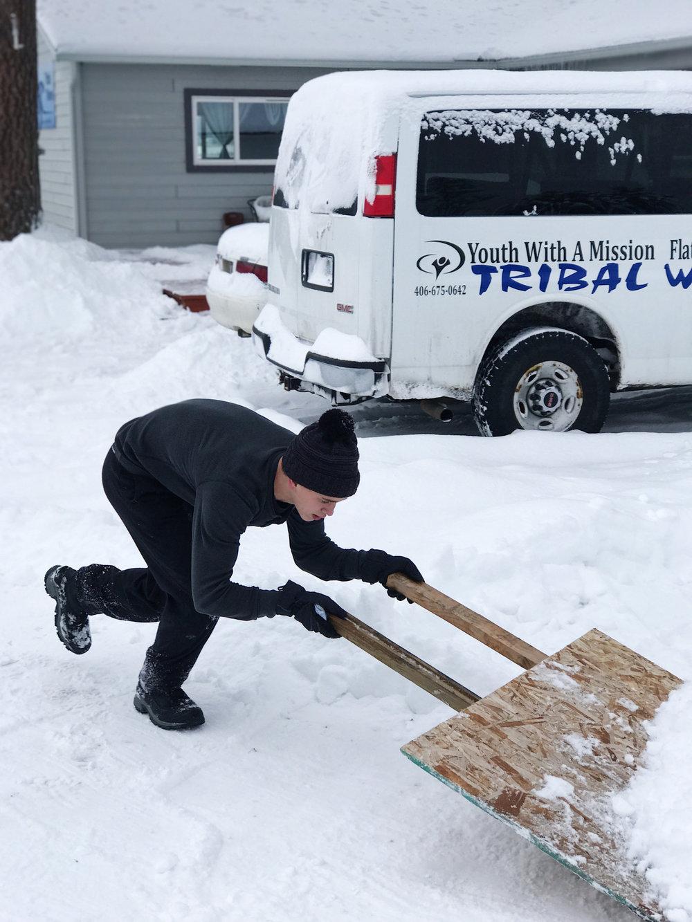 Christian Shoveling Snow.