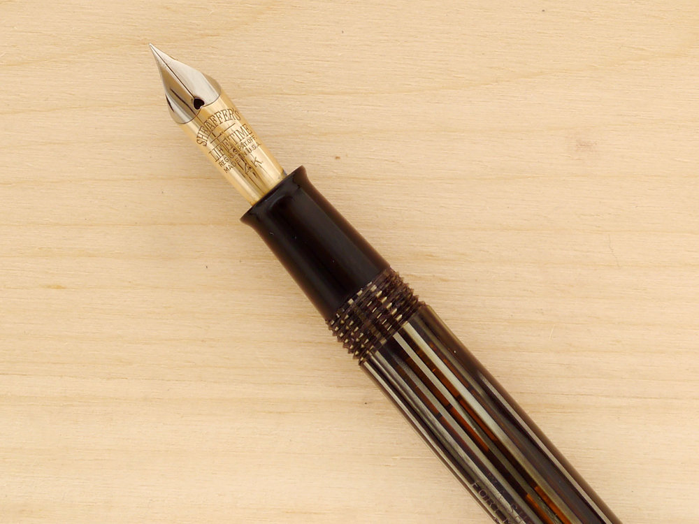 Sheaffer Balance Vac, Gray Pearl, Needlepoint, a close-up of the nib, also showing transparency of the barrel (the warm tones)