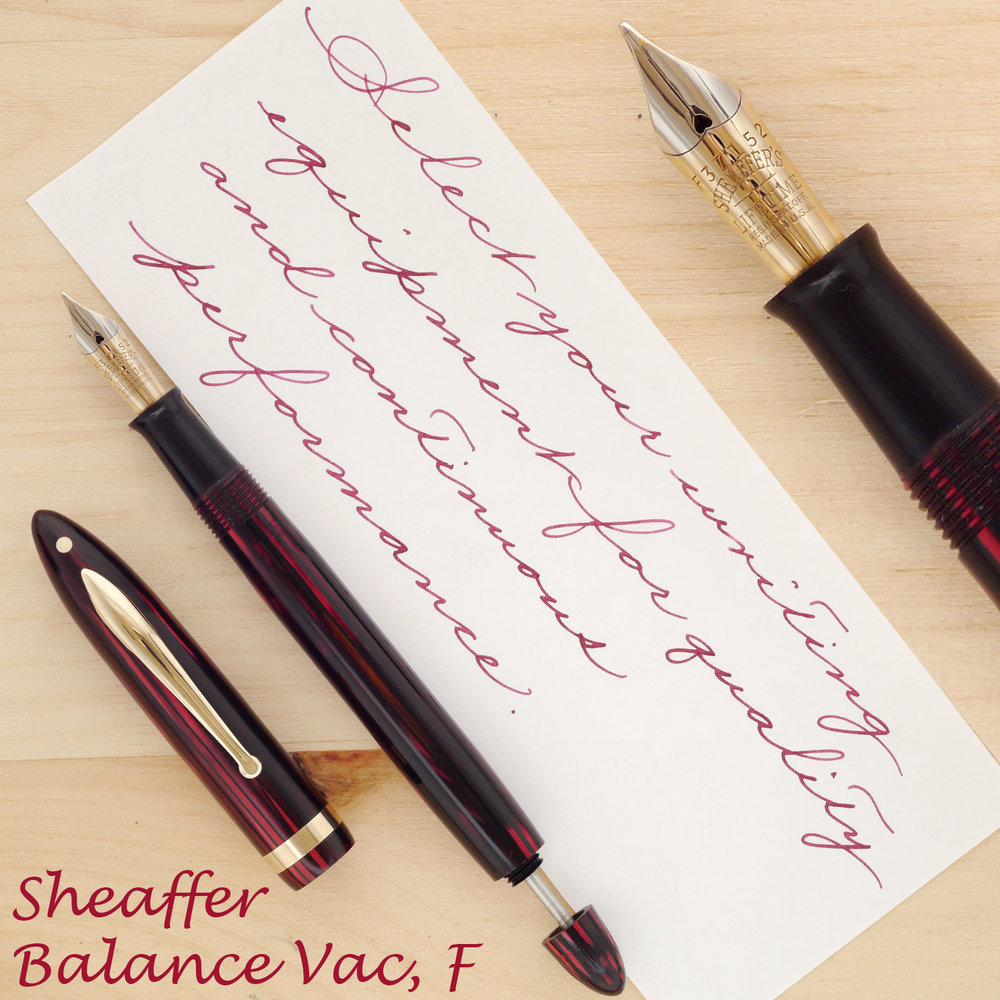 Sheaffer Balance Vac-filler in Carmine, F, with the cap off and the plunger rod partially extended