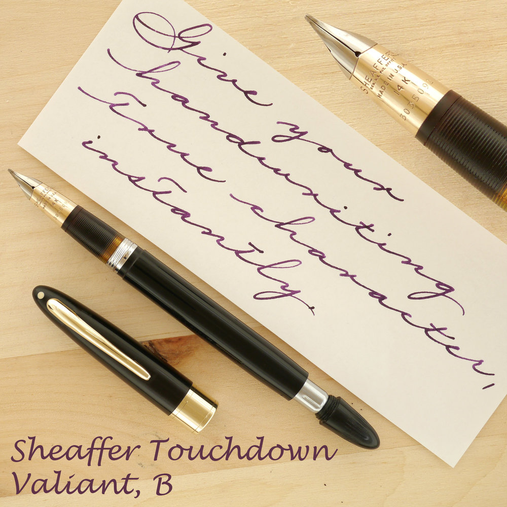 Sheaffer Touchdown Valiant, B, uncapped, with the plunger partially extended