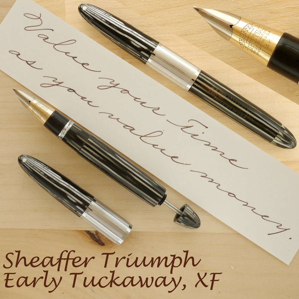 Sheaffer Triumph Tuckaway (Early) Gray Pearl, XF, with the cap on, off, and plunger partially extended