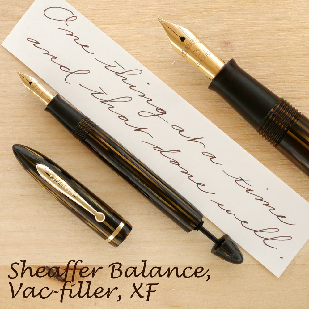 Sheaffer Balance Vac-filler, Golden Brown, XF, uncapped, with the plunger partially extended