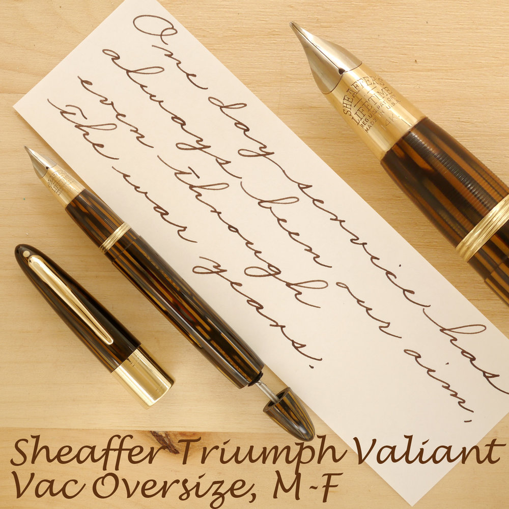 Sheaffer Triumph Valiant Vac Oversize, Golden Brown, F-M, uncapped, with the plunger partially extended