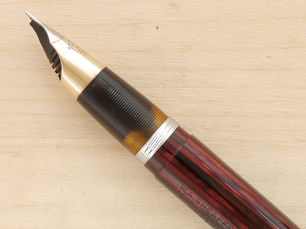 Sheaffer Triumph Statesman Tuckaway, Carmine, XF, nib profile showing excellent tipping geometry and alignment, a clear ink window, and strong imprint