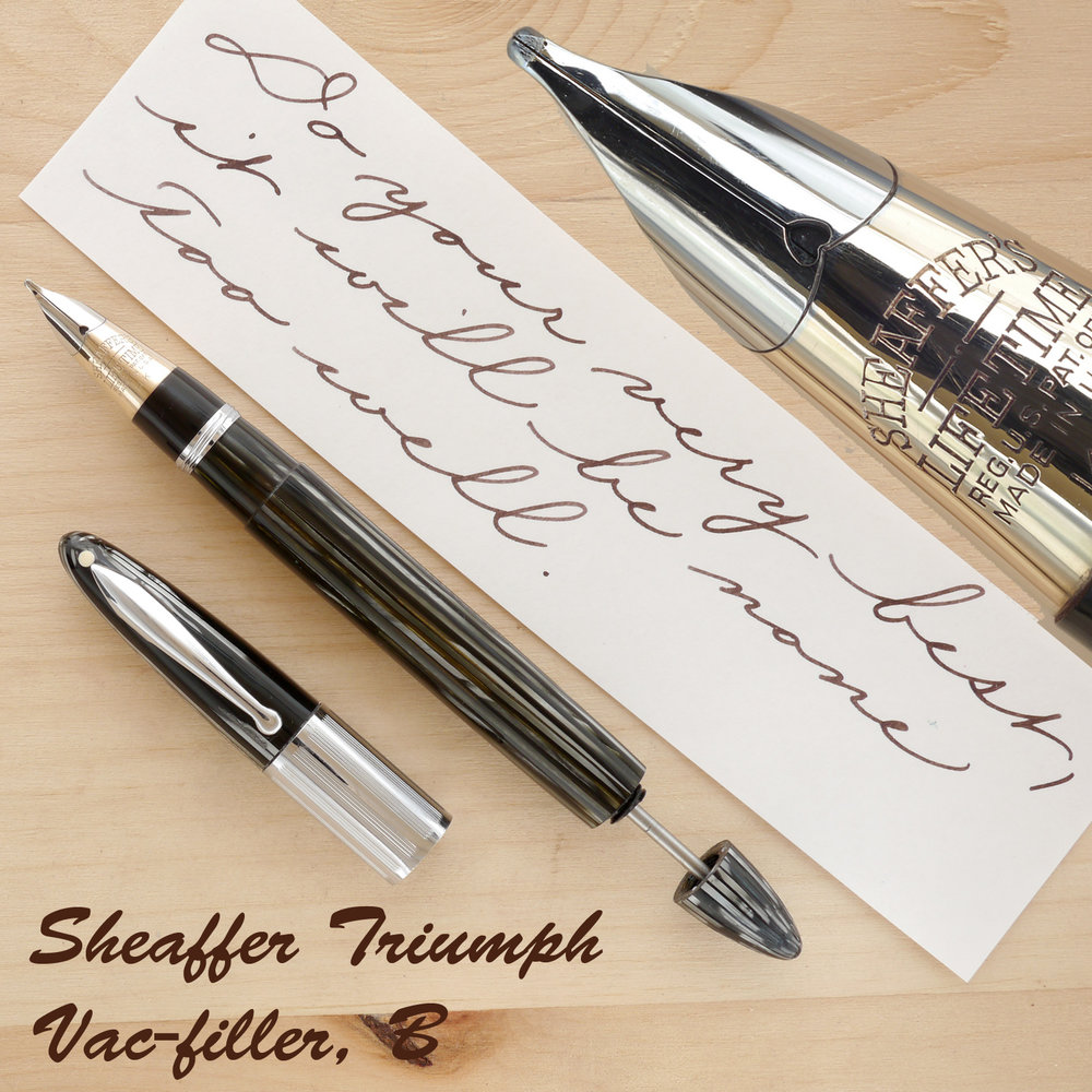 Sheaffer Triumph Vac, Gray Pearl, B, uncapped, with the plunger partially extended