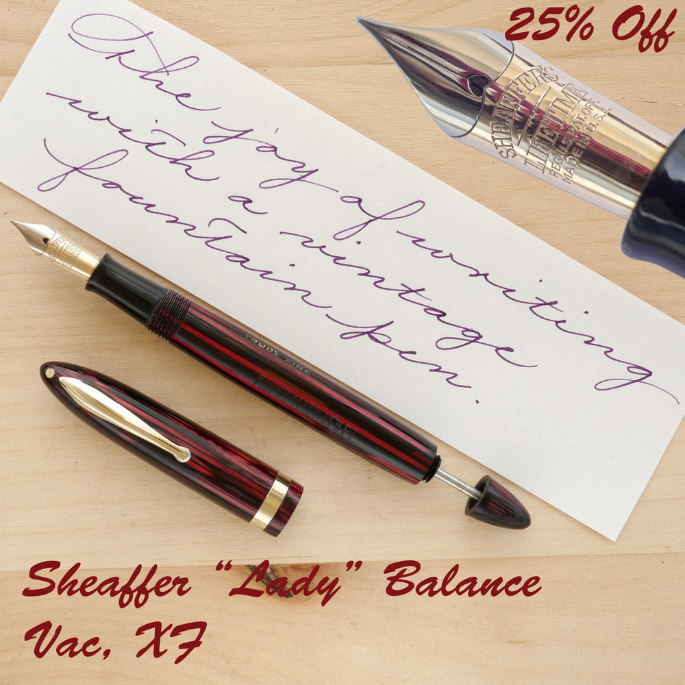 "Sheaffer ""Lady"" Balance Vac, Carmine, XF, uncapped with the plunger partially extended"
