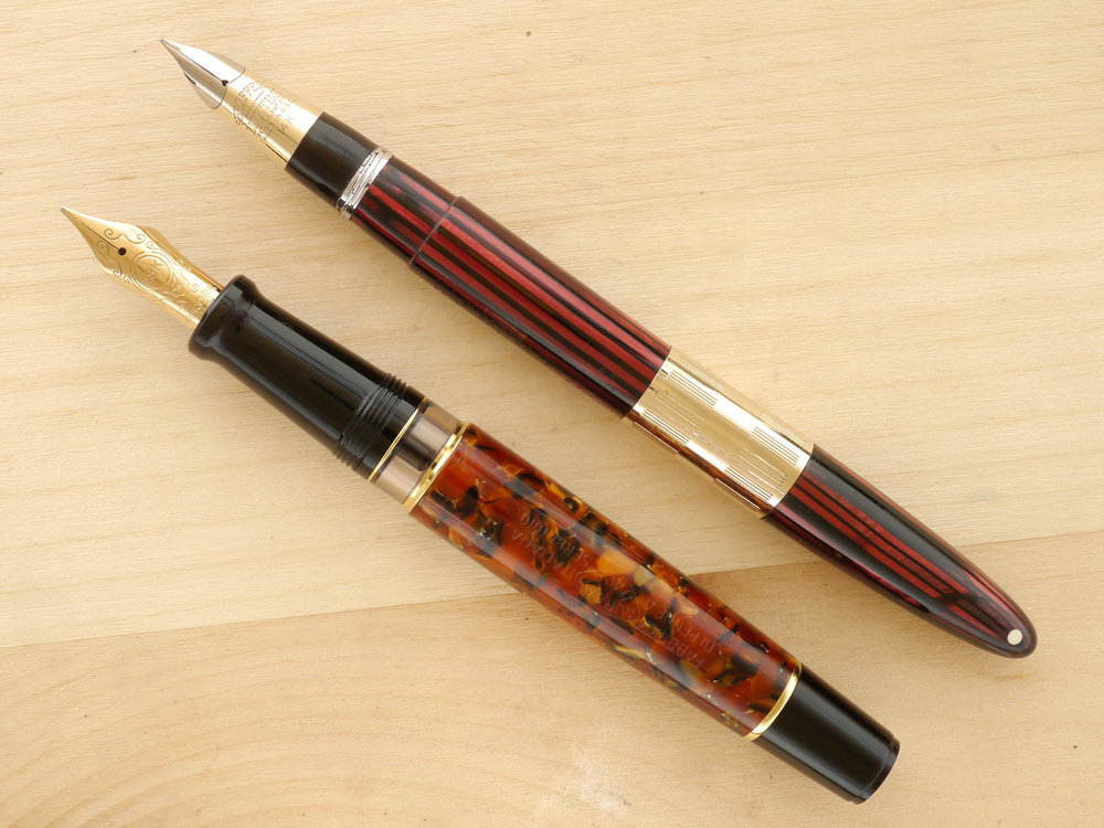 Sheaffer Triumph Tuckaway (early), Carmine, XF, compared to the modern Aurora Optima