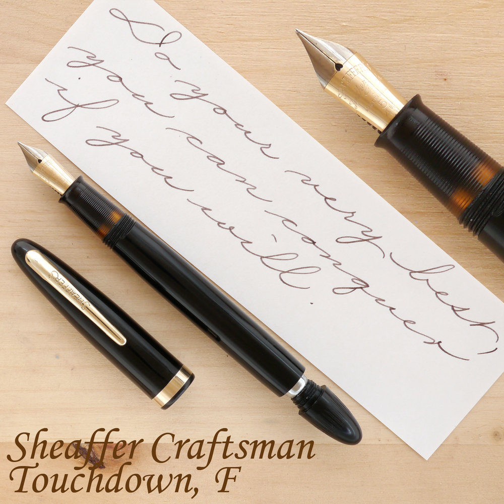 Sheaffer Craftsman Touchdown Fountain Pen, Black, F, uncapped, with the plunger partially extended