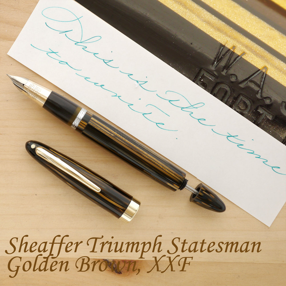 Sheaffer Triumph Statesman Fountain Pen, Golden Brown, XXF, uncapped, with the plunger partially extended