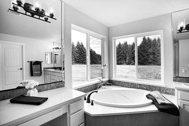 Architectural photography by Corey Schatz.  #jacuzzitub #modernbathroom #bathroom #architecturalphotography #relax #architecturalphotographer #realestate #realestateagent #realestatemarketing #hometour #olympia #lakewood #tacoma #seattle #washington #hdrphotography #canonusa #evergreenstate #livingroom