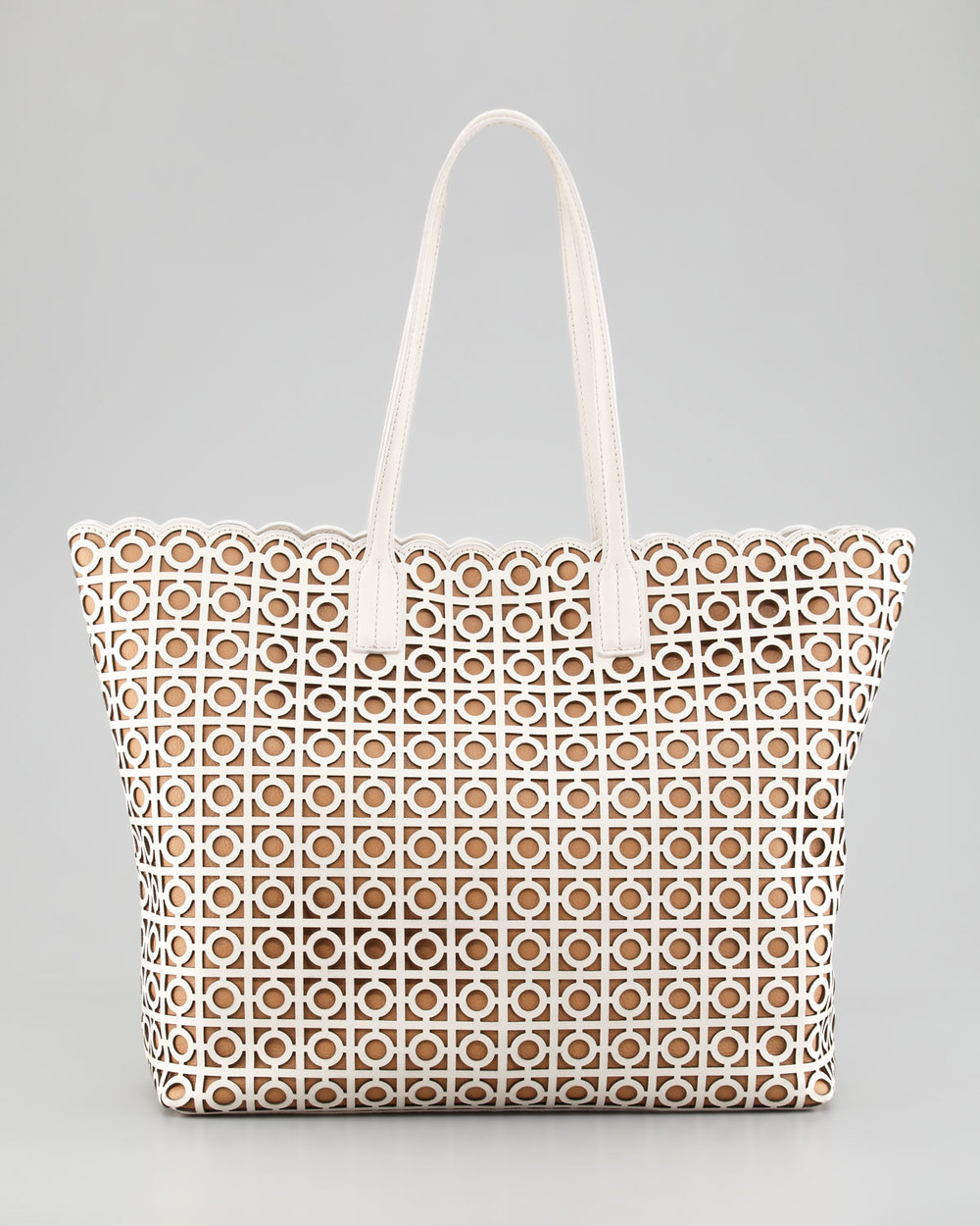 tory-burch-white-kelsey-lasercut-eastwest-tote-bag-product-1-6080679-938965542.jpeg