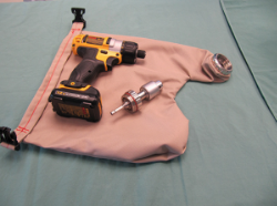 This drill cover is a waterproof, autoclaveable surgical bag that connects to the drill's mechanics via a sealed bearing mechanism. It can survive 100 sterilisations.     Turns an everyday power drill from the hardware store into a surgical device.      Find out more here.