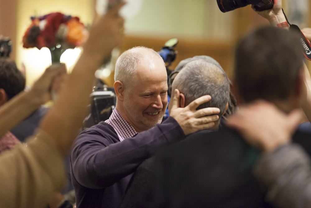 A couple share a moment after a gay marriage ceremony is performed. Eight couples participated after midnight at City Hall in Jersey City, New Jersey, the minute gay marriage became legal.