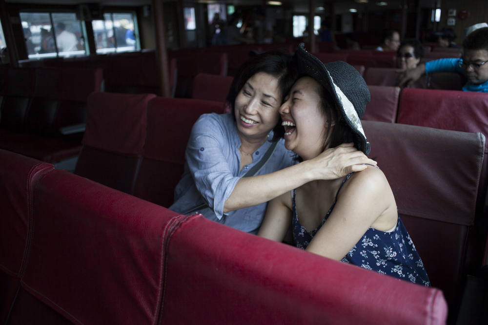 My mother and Soobin laugh together while on a ferry tour. Soobin is her niece. My mom has raised her since she was 10.