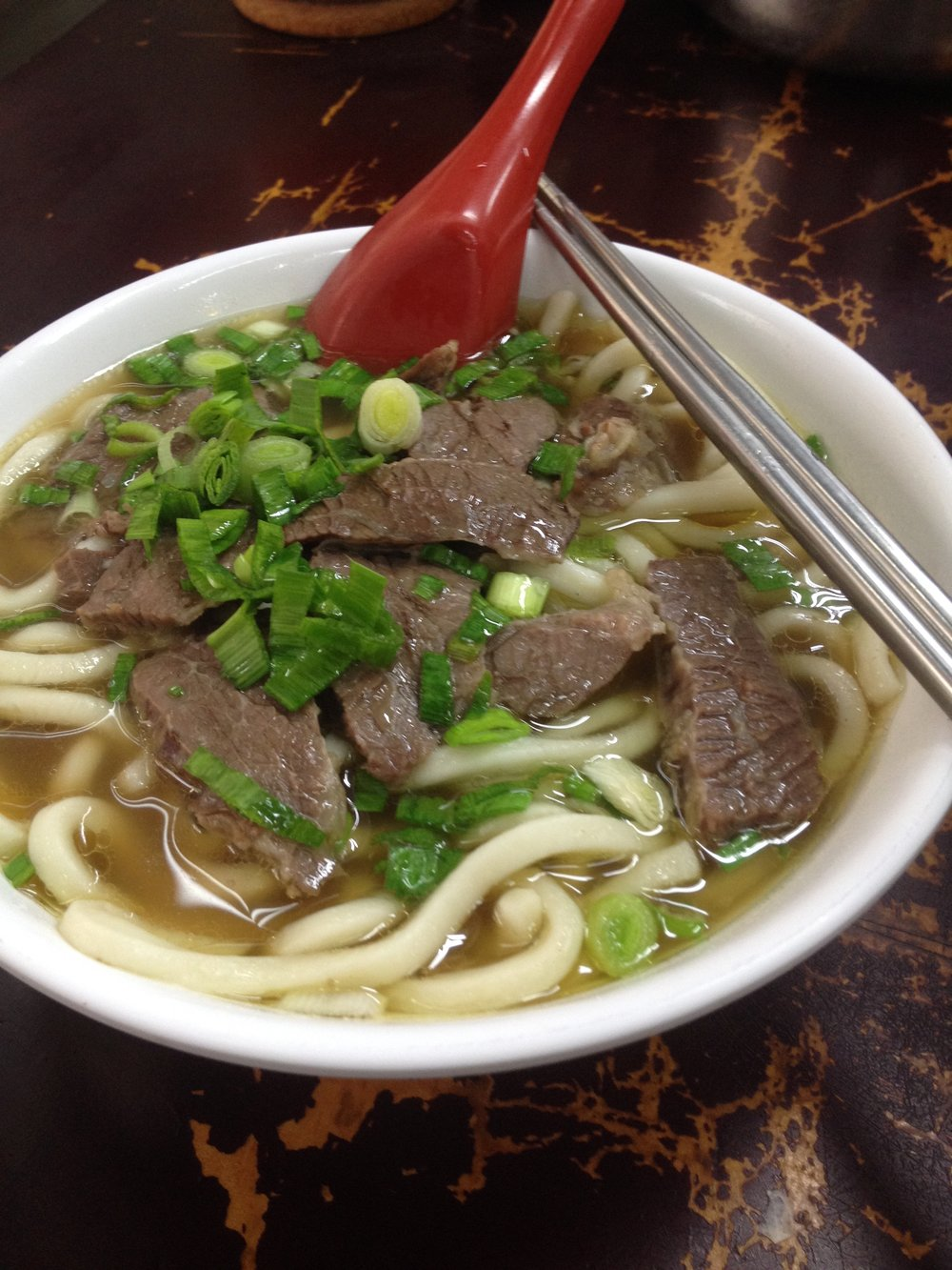 Beef noodle soup from a local shop near Taipei Main Station.