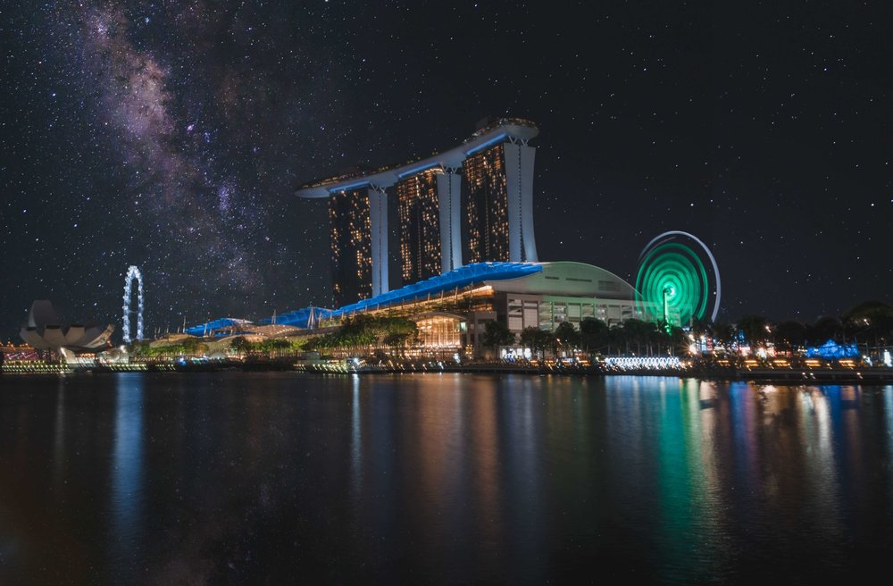 The iconic Marina Bay Sands building at night. Singapore is much more than meets the eye.
