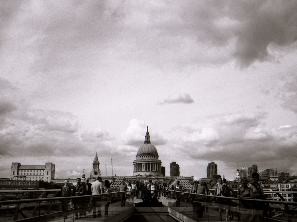 View of St Paul's Cathedral from the Millennium Bridge, London, England (Summer 2013)  // Fuji Neopan Acros 100, Olympus OM-2n, Epsom V330 // I can't help but be moved by the view of St Paul's Cathedral constructed in 1675 whilst stood on 'Millennium Bridge', a 'swinging bridge' that opened in 2000. It is amazing how the British landscape has evolved over the past 500 years. How do we preserve awe inspiring heritage whilst creating awe inspiring, socially relevant innovation? There is beauty both in the past and in the future.