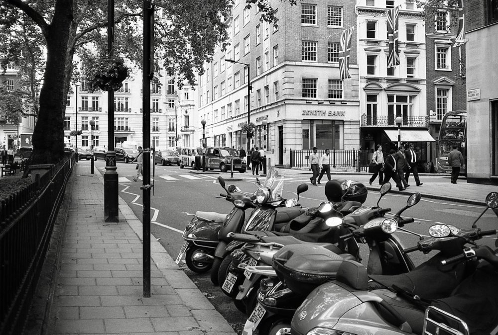 Motorcycles on Berkeley Square, Mayfair, London, England (Summer 2012)  // Kodak T-Max 100, Zorki-4, Epson V330 // Technology meets heritage yet again. How should we blend them? Can we retain the integrity of something beautiful and old whilst moving into the future?