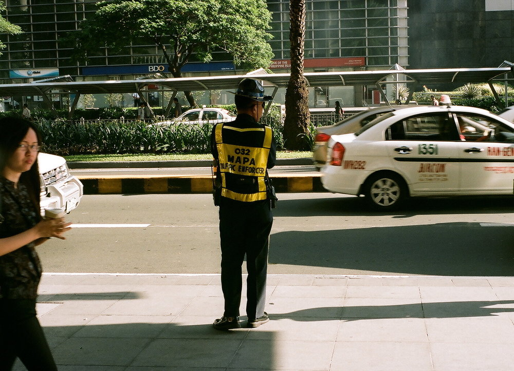 On the lookout, Makati, Manila, Philippines (Summer 2013)  // Kodak Portra 160, Mamiya ZE-2, Epson V330 // Keeping Manila, a city riddled with terrible traffic, moving is the mission of these men.