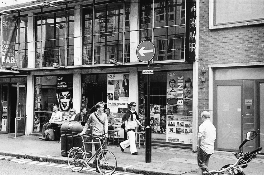 Soho Theatre, London, England (Summer 2013)  // Fuji Neopan Acros, Olympus Om-2n, Epson V330 // I found the moment of two people walking in opposite directions to one man and a sign quite amusing. Although the sign is meant for traffic, the sense of tension of opposites makes me think of the joy and pain of those who go against the grain.