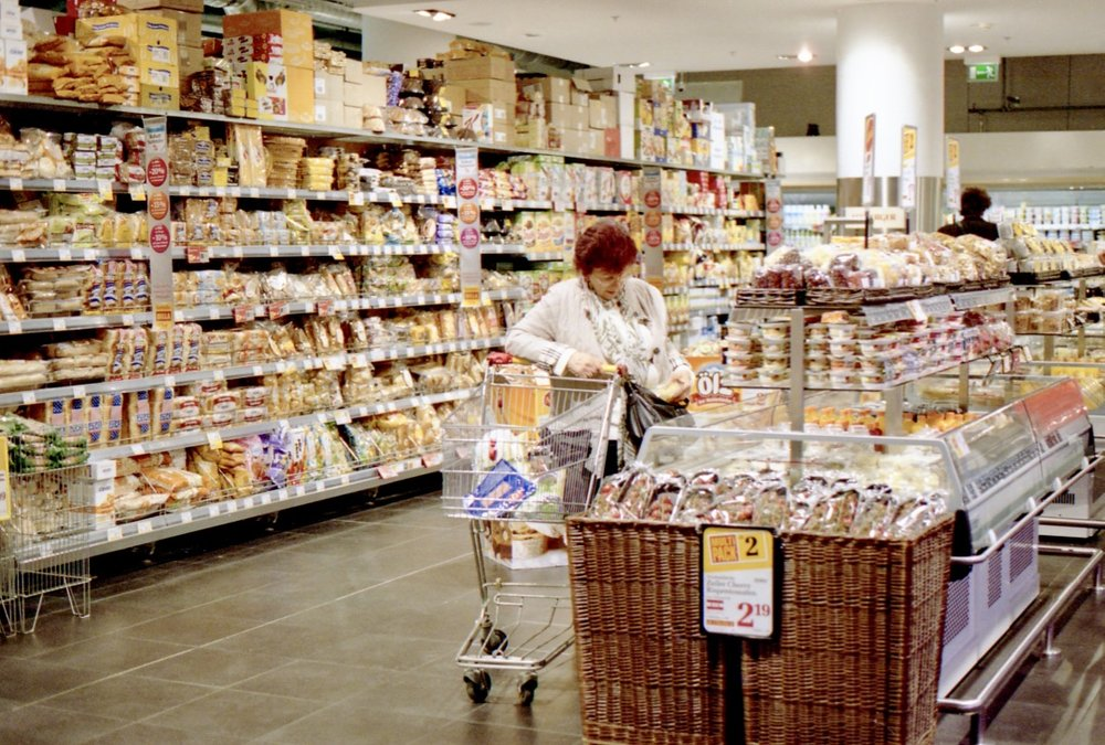 Everyday experience, Supermarket Unknown, Vienna, Austria (Spring 2013)  // Kodak Portra 400, Olympus Om-2n, Epson V330 // I cannot quite tell if she is stealing or reading the back of the packet but I do wonder how this simple experience of heading to the supermarket is going to change or rather how can we improve it? Can we make it waste free? Can we enhance the quality of interaction between people? Do we need to have tills?