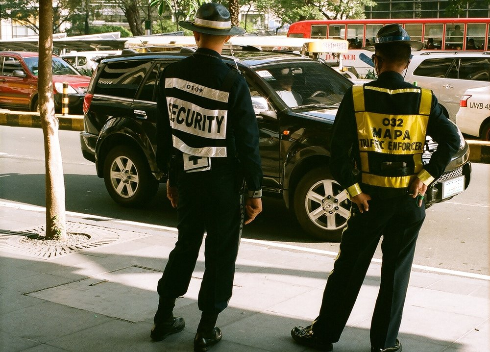 Structure and safety, Makati, Manila, Philippines (Summer 2013)  // Kodak Portra 160, Olympus Om-2n, Epson V330 // What role do humans have in the experience of safety? If we replace a human with a computer, do we feel as safe or as cared for? A March 2017 article in  WIRED ,  Silicon Valley Would Rather Cure Death than Make Life Worth Living , explores the downside of our addiction to creating with technology. Perhaps then, our then we can shift our creative efforts into making with humans in mind, not for efficiency, but for cultivating and enriching life experience.