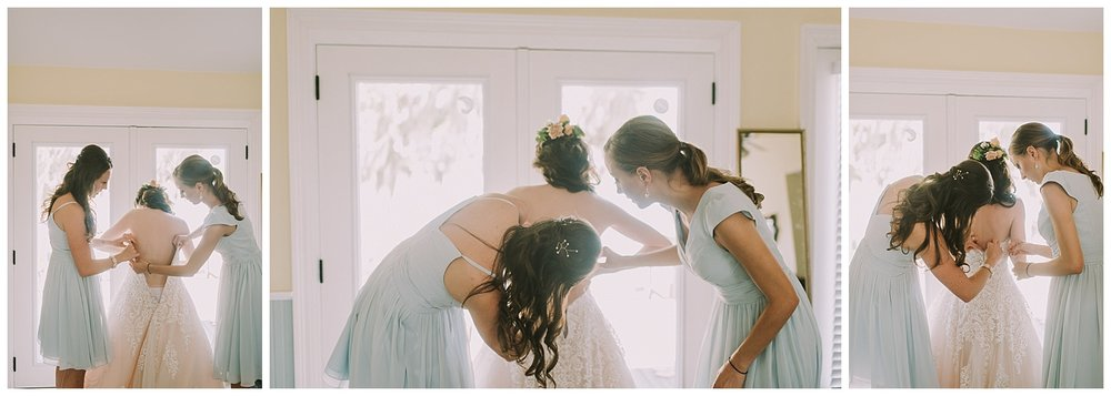 Bride Getting Dressed with Bridesmaids