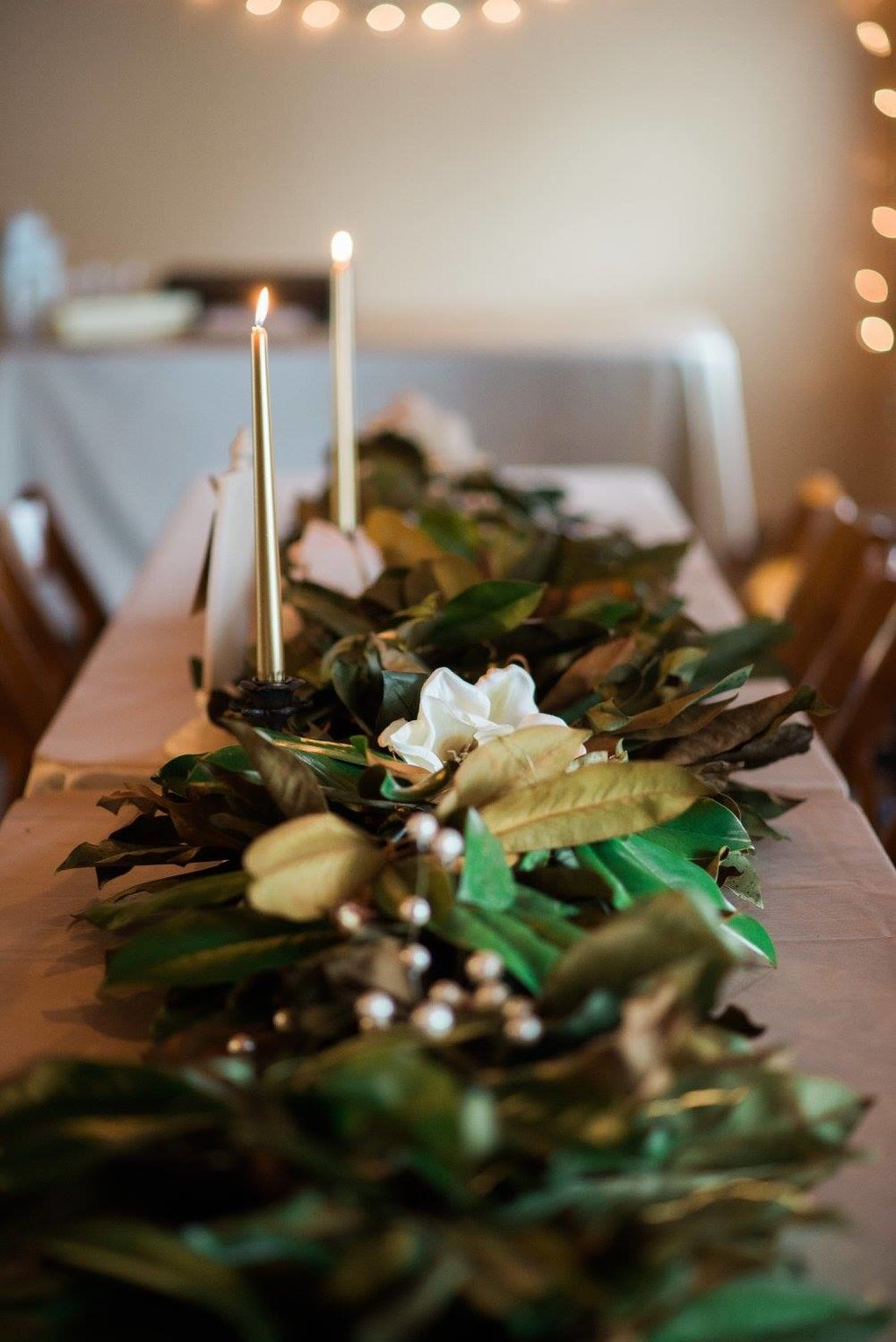 Louisiana Grown - This couple incorporated magnolia flowers and magnolia leaves into her wedding. Magnolias are a symbol commonly associated with Louisiana.
