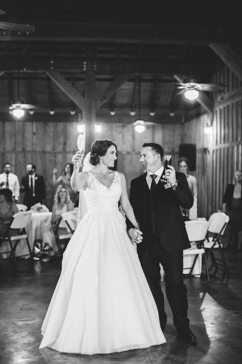 Rustic Weddings - This couple opted for a reception venue with natural exposed wood and their ceremony was outdoors underneath an oak tree.