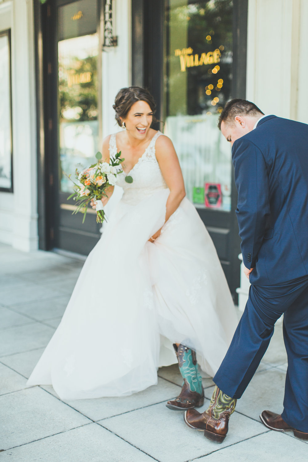 Rustic Attire - This couple chose to incorporate their love for western style boots into their wedding. During their first look they showed each other their boots and the joy on the brides face is evident.