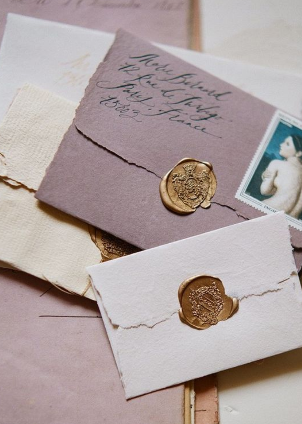 Vintage Inspired Stationery - These hand addressed envelopes with vintage stamps and a gold wax seal are gorgeous.