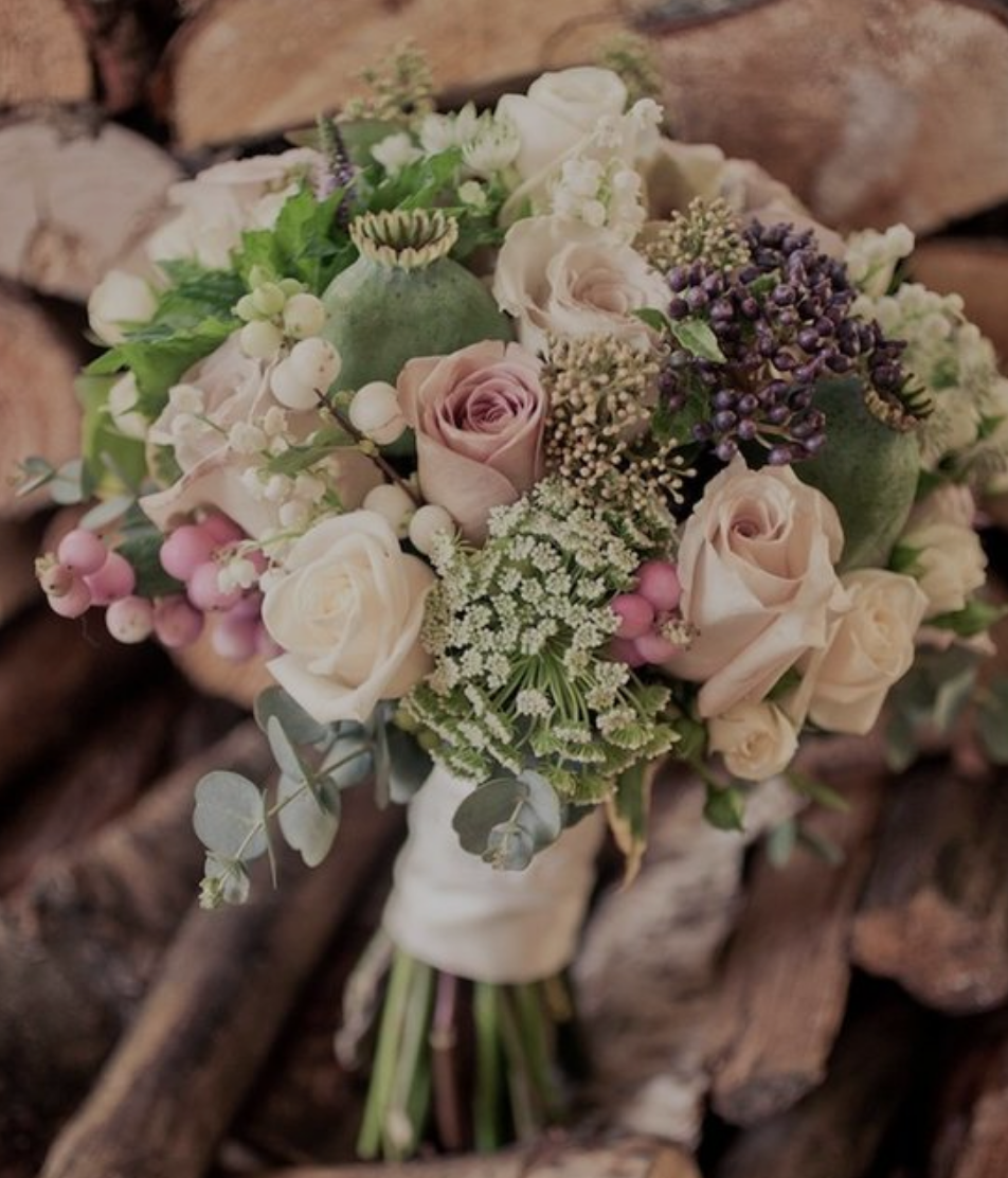 Vintage Weddings - Weddings with a vintage feel usually use muted colors in their bouquets. They also feature traditional flowers, such as pink and white roses.