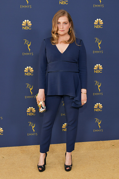 Actress Merritt Wever holds our CLIO Edition clutch on the red carpet at the 2018 Primetime Emmy Awards. The bag is wrapped in the fabric from a 1980s vintage Chanel scarf.  -
