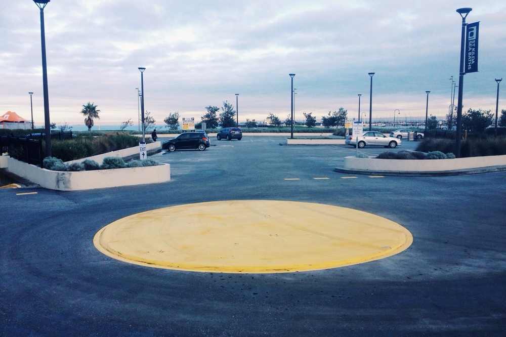 No lovers in the parking lot, just a big yellow sun.