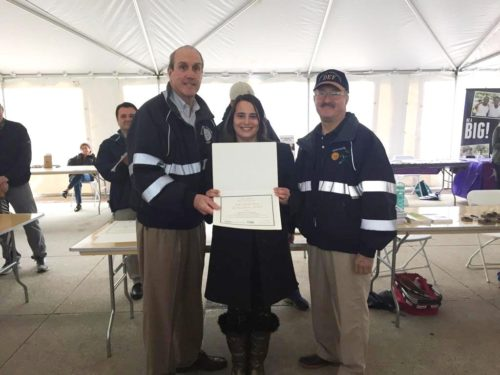 Laura LoBreglio of BBBS of FSW receives Westchester County's Reuse and Recycle Award from Deputy County Executive Kevin Plunkett (L) and Department of Environmental Facilities Commissioner Thomas Lauro (R) at the Earth Day ceremonies May 13, 2017, at Kensico Dam.