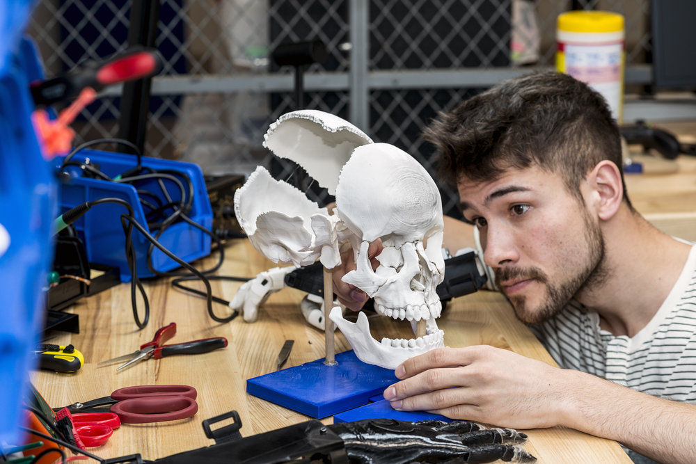 2nd year medical student, Justin Turpin, making some final adjustments on his 3D printed skull model.