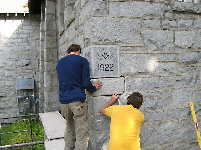 Masons remove the time capsule from the cornerstone of st.  saviour's, nelson in september 2011.