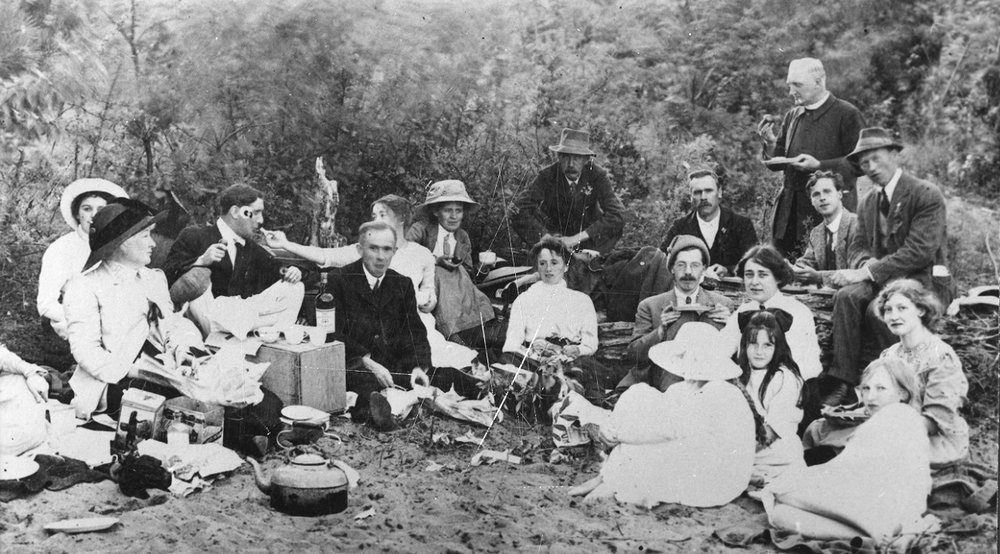 st. michael's, kelowna choir picnic at poplar point 1904.  l-r:  mrs. dennison, mrs. royal, mrs. greene, mr. mengems, mr. royal, mrs. mengems, mrs. palgella, mr. rogerson, mrs. gay, mr. rogers, archdeacon greene, p. dunn, martin ward, police thomas, babe greene, nellie shaylor, mr. dennison, mabel greene.