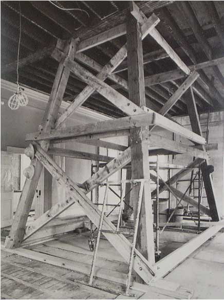 Shoring tower supported second floor trusses while holes were drilled for hanger rods suspended from steel beams in the attic. System was designed by Nicholas L. Gianopulos, drawing on work he did earlier in Park buildings.