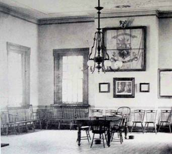 Photo c. 1870 shows chairs by William Sanderson, gaslight chandelier and tile floor. Central heating replaced fireplaces, which were sealed until restoration in late 1960's.