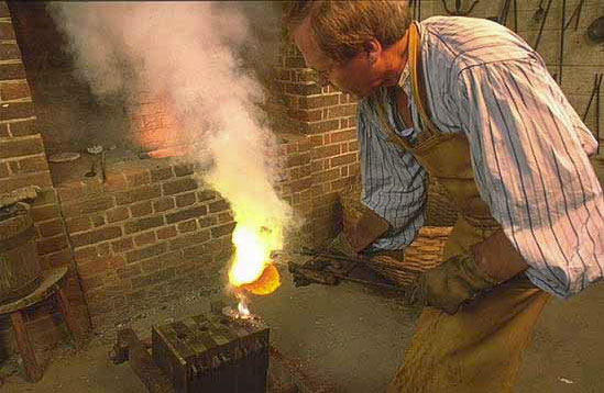 Founder pours molten brass into molds. Files made in adjoining shop were used to smooth rough castings. Using a heavy mallet and sharp chisel, file-maker cut a pattern of parallel grooves in a steel blank. Each blow made an indentation and raised a small ridge of metal. File-makers were paid by the number of inches of file they cut. (courtesy: Colonial Williamsburg Foundation)