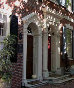 "A pair of town houses on Spruce St. portray the ""house carpenter"" in his prime. At right (No. 427) lived the first French consul general to the United States. Dolley Madison and her second husband, James Madison, lived next door (No. 429)."