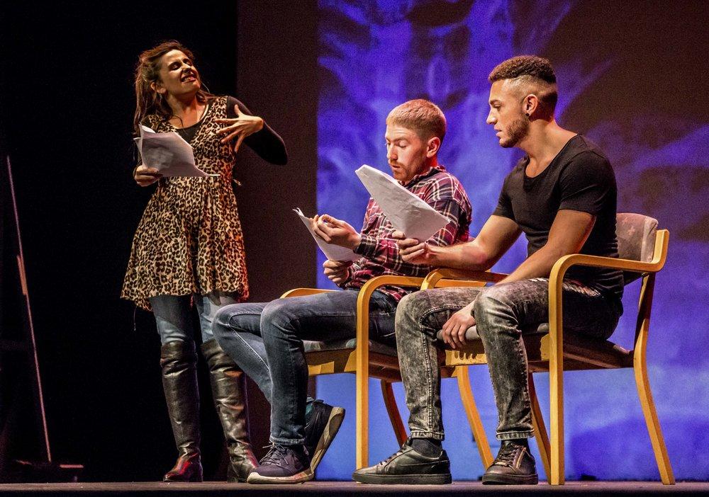 Actors performing script in hand