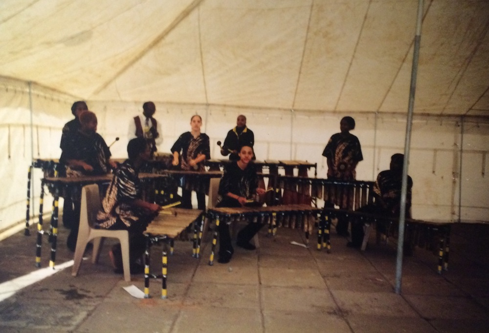 Performing at Main Mall in Gaborone, 2003.  (Left to right - Front row: Goroma, Otto, Lesego. Middle row: Tshepiso, Liliana, Sharon. Back row: Bonolo, Mr Mhlanga, Moipone.)