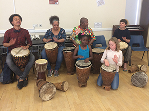 Mixed adults and children  drumming workshops during  Africa Day festivities, 2016