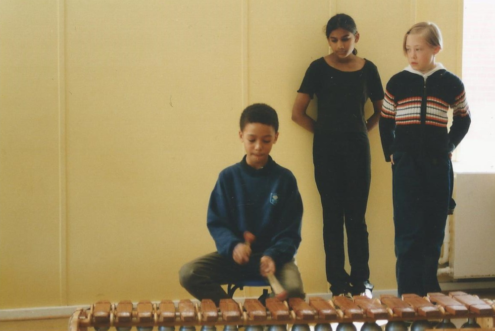 Sharing some songs with a very young Zimba Marimba in Åstorp, 1998.