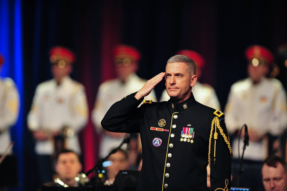 "Col. Andrew J. Esch, Leader and Commander of The U.S. Army Band ""Pershing's Own,"" salutes veterans of the Vietnam War."