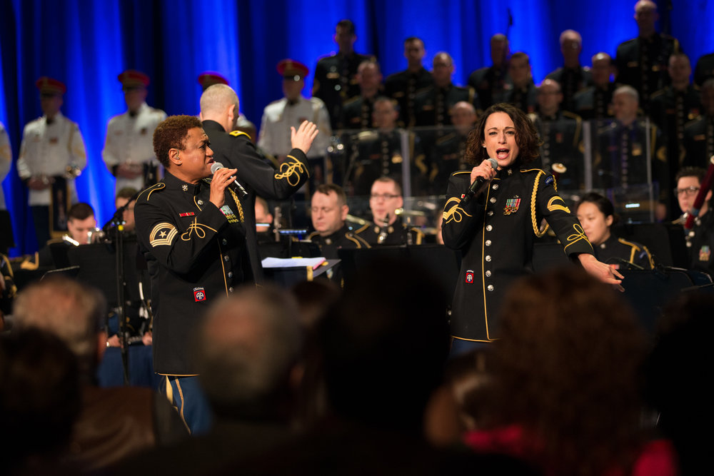 "Members of the U.S. Army Band ""Downrange"" perform music of the 1960s for veterans."