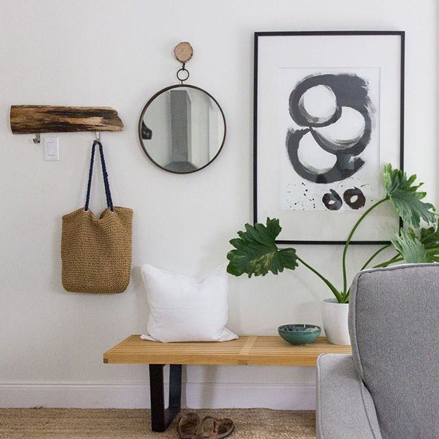 My tiny non-entry is very functional with a bench, rug, hooks, mirror and bowl for keys and sunglasses, etc.  The #essentials!  #simplehomesimplelife #essentialisthome #natureinthehome #whitehome #entrywaydecor #myhousebeautiful #apartmenttherapy #acornerofmyhome