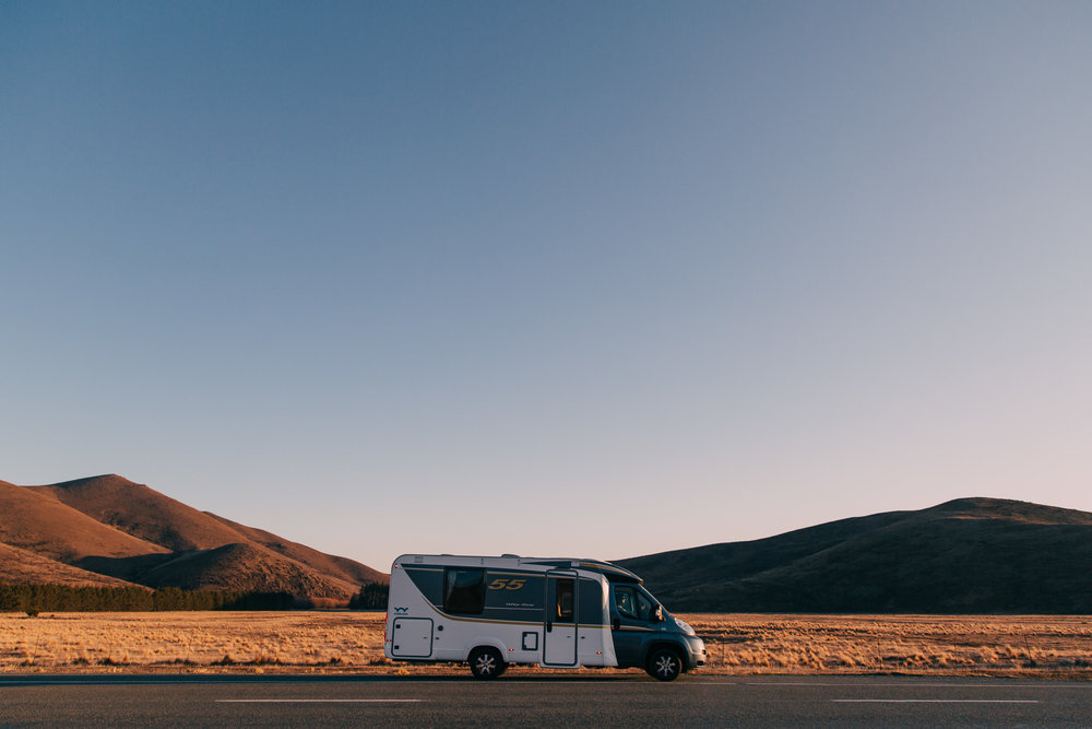 Wilderness motorhome on the road during sunset in the South Island of New Zealand
